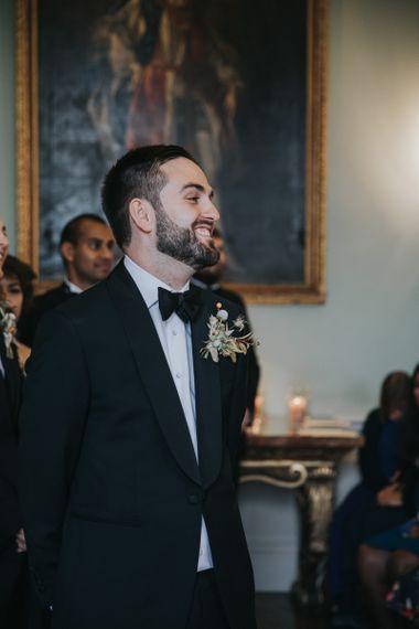 Grooms Smiles As Bride Walking Down The Aisle