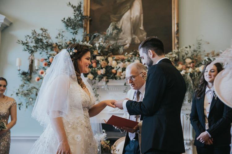 Bride and Groom Exchange Rings During Wedding Ceremony at Oxfordshire Wedding Venue
