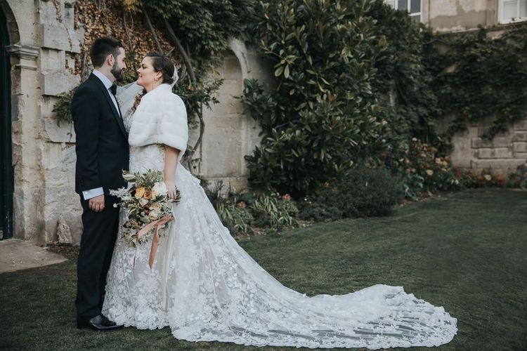 Bridal Faux Fur Cover Up For Winter Wedding With Groom In Tux at Oxfordshire Wedding Venue