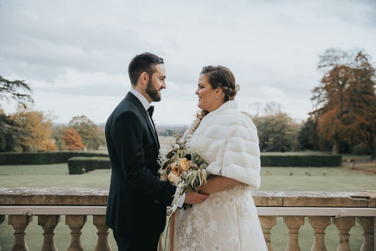 Bride Wears Faux Fur Cover Up For Winter Wedding