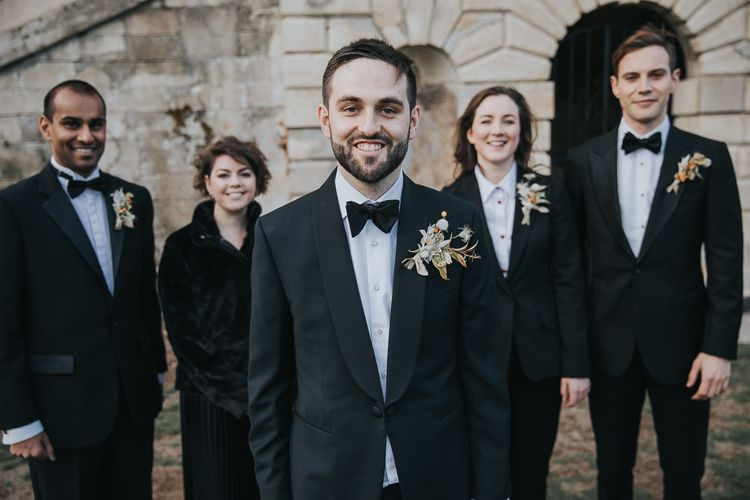 Groom and Grooms Party In Suits With Buttonholes at Kirtlington Park Wedding Venue