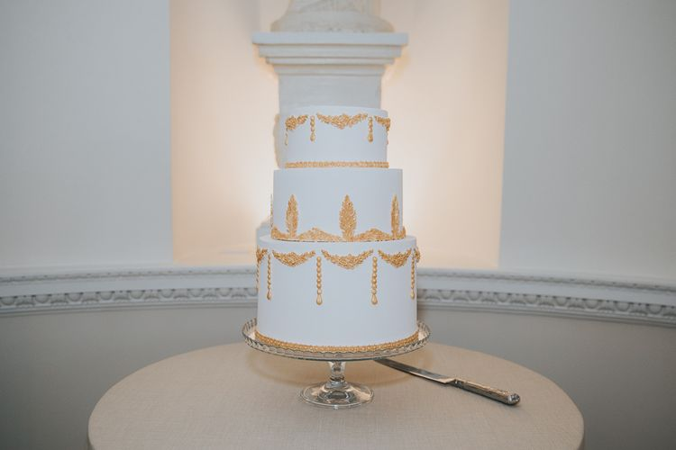 White Wedding Cake With Gold Detail