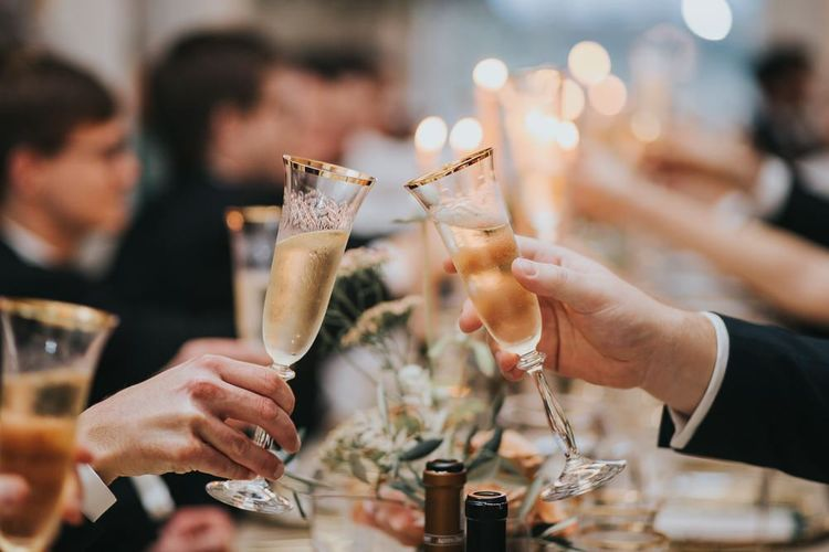 Guests Toast Bride and Groom With Champagne
