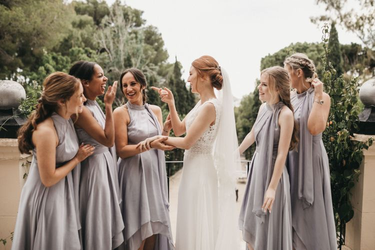 Bride and Bridesmaids Laughing on the Wedding Morning