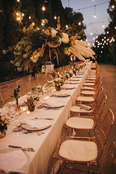 Long Wedding Reception Table with Festoon Light Canopy
