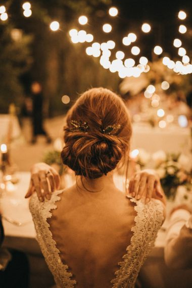 Bride in Low Back Pronovias Wedding Dress with Chic Wedding Hairstyle