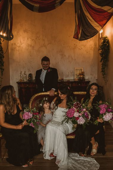 Bridal Party on the Wedding Morning with Bride in Emanuela Grace Loves Lace Off The Shoulder Wedding Dress, Bridesmaids in Black Dress and Young Daughter in a Tutu