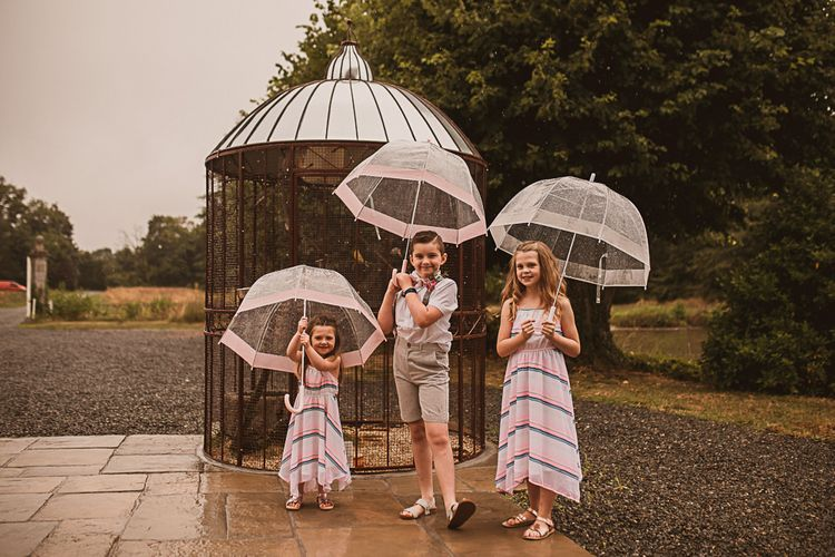 Children Holding Umbrellas
