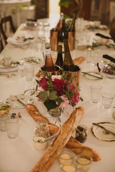 Table Decor with France Sticks and Pink Flower Centrepieces featured on escape to the chateau