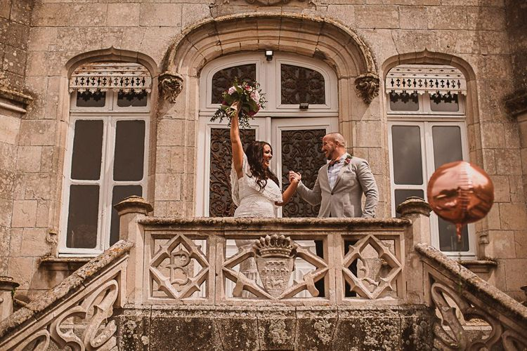 Bride and Groom Cheering on the Steps of their French Chateau de la Motte Husson Wedding