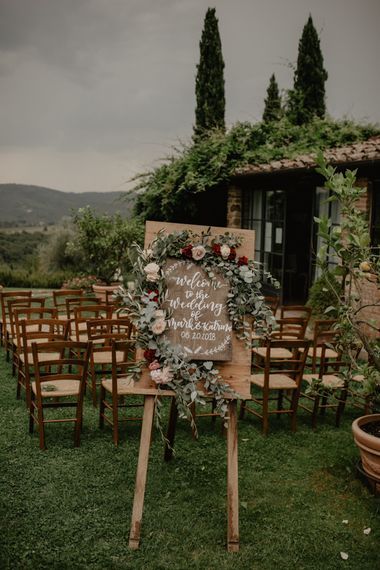Wooden Welcome Sign on an Easel at Outdoor Ceremony