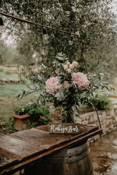 Wooden Bar Sign and Pink Hydrangeas and Eucalyptus Wedding Flower Decor