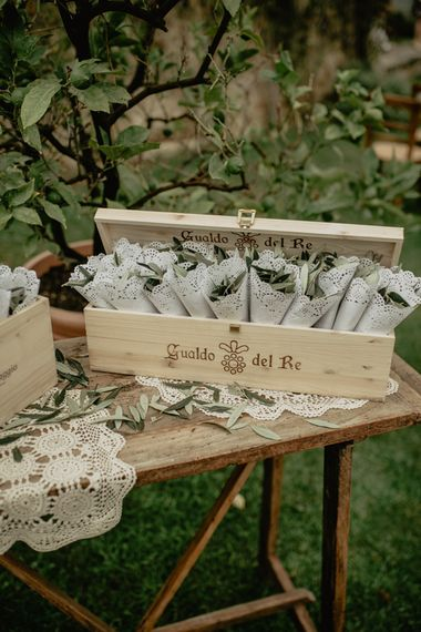 Wooden Box Filed with Confetti Cones of Olive Leaves