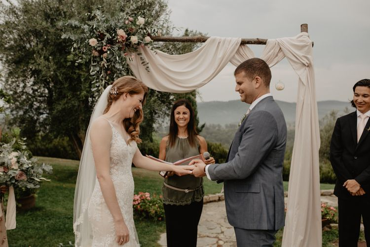 Bride and Groom Exchanging Vows at their Outdoor Wedding Ceremony