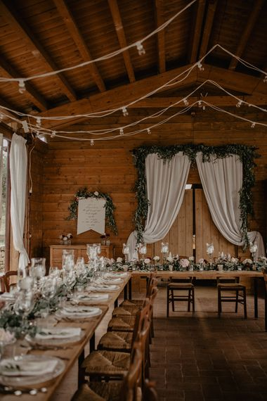 Rustic Wedding Reception Decor with Fairy Lights and Drapes