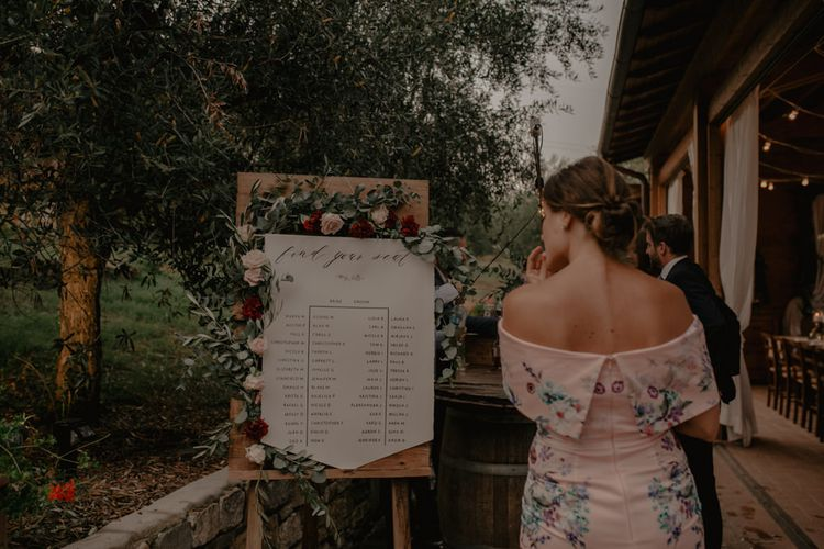 Wooden Seating Chart with Floral Garland Wedding Decor
