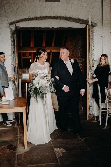 Ceremony bridal entrance in chiffon wedding dress with lace jacket
