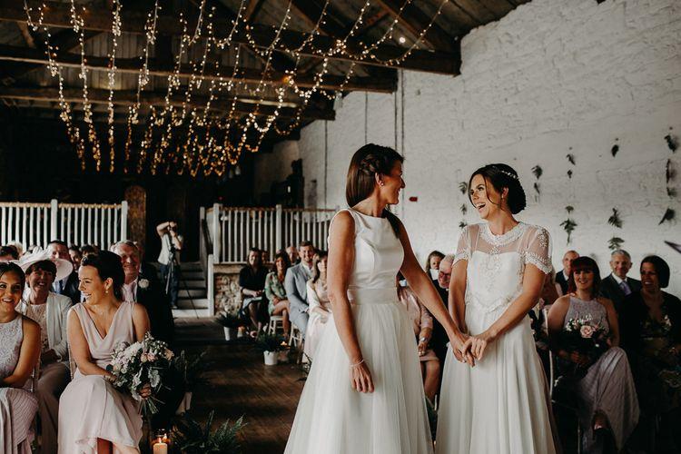 Lesbian wedding at Askham Hall with fairy light ceiling decor