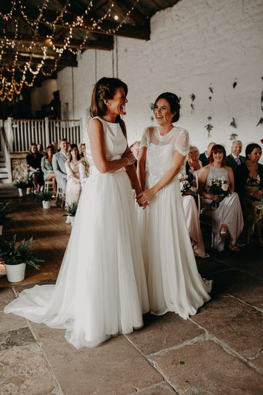 Same sex wedding with brides in chiffon and lace and satin and tulle wedding dresses