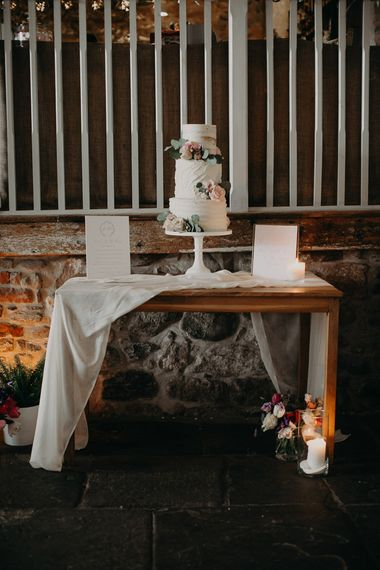 Cake table with three tier buttercream  cake