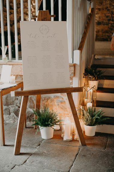 Seating chart on wooden easel
