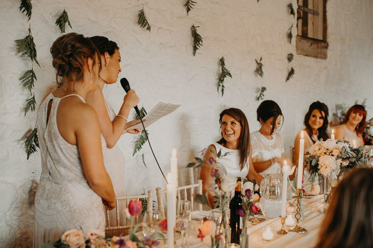 Best girl wedding speech with fern covered wall