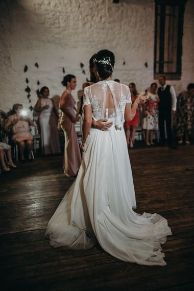 Lesbian wedding first dance with bride in lace coverup