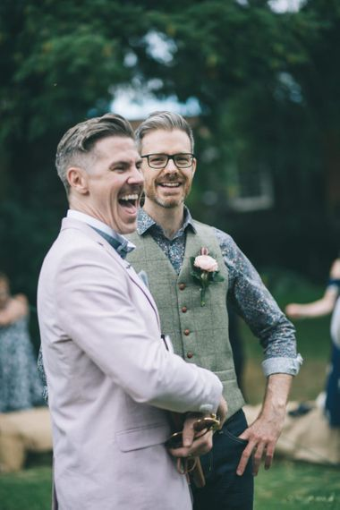 Wedding Guest in Pink Suit and Groom in Tweed Waistcoat and Floral Shirt