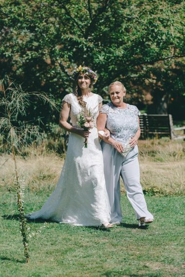 Outdoor Wedding Ceremony with Bride Being Escorted Down the Aisle by Her Mum