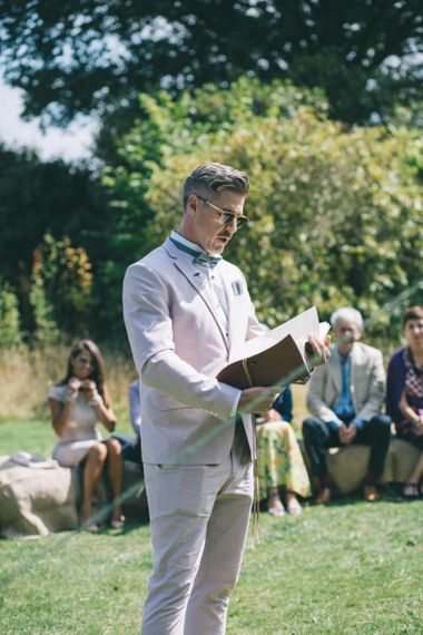 Officiant Friend in Pale Pink Wedding Suit