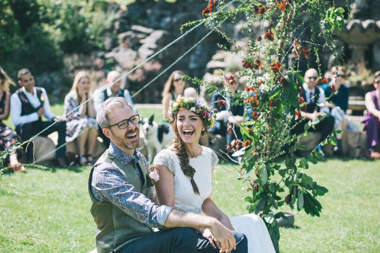 Outdoor Wedding Ceremony with Bride  in Lusan Mandongus Wedding Dress and Flower Crown and Groom in Floral Shirt and Tweed Waistcoat