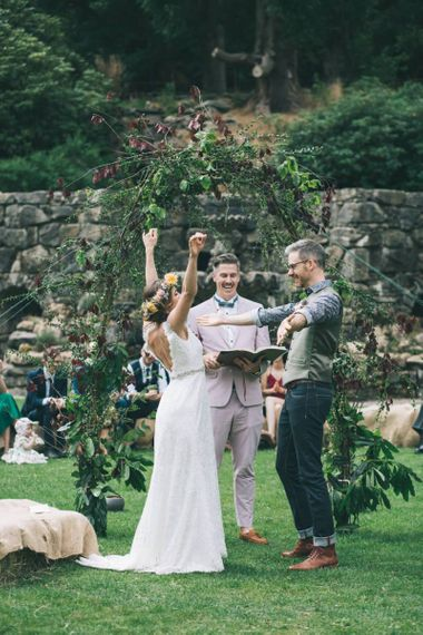Wedding Ceremony with Bride  in Lusan Mandongus Wedding Dress and Flower Crown and Groom in Floral Shirt and Tweed Waistcoat