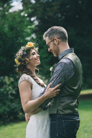 Groom in Floral Shirt and Tweed Waistcoat Embracing His Bride  in Lusan Mandongus Wedding Dress and Flower Crown