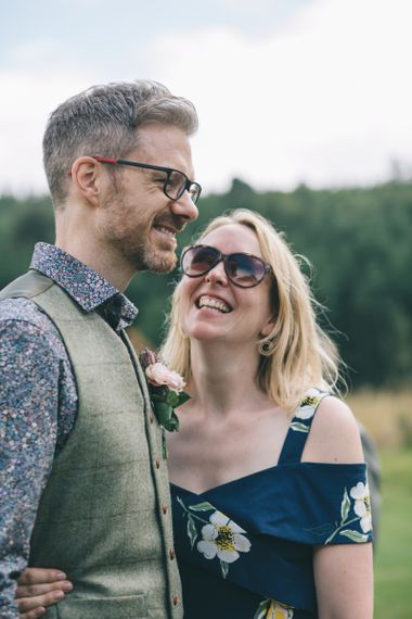 Wedding Guest Embracing the Groom in a Tweed Waistcoat and Floral Shirt