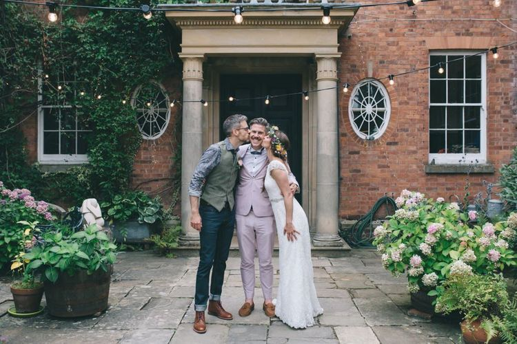 Bride and Groom and Wedding Guest
