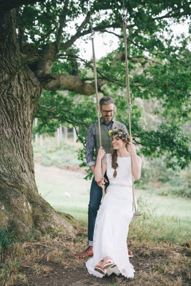 Groom in Floral Shirt and Tweed Waistcoat Pushing his Bride in Lusan Mandongus Wedding Dress and Flower Crown on a Swing