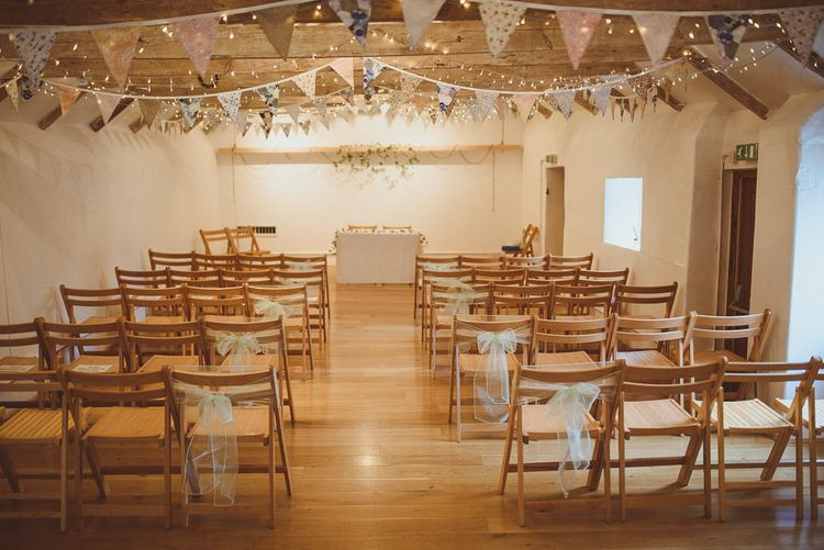 Ceremony Aisle & Altar Decor | Pastel Bunting & Fairy Lights | Fusion Rustic Indian Country Wedding at The Green Cornwall | Matt Penberthy Photography