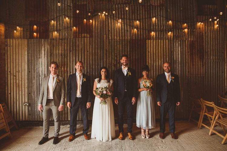 Wedding Party | Bride in Gatsby Lady Gown | Bridesmaids in ASOS Dress | Groomsmen in Navy Reiss Suits | Fusion Rustic Indian Country Wedding at The Green Cornwall | Matt Penberthy Photography