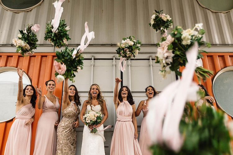 Bride In Suzanne Neville And Bridesmaids In Pink Multiway Dresses // London Wedding Venue For 300 People Trinity Buoy Wharf With Bride In Suzanne Neville And Images From Paul Joseph Photography Film This Modern Revelry