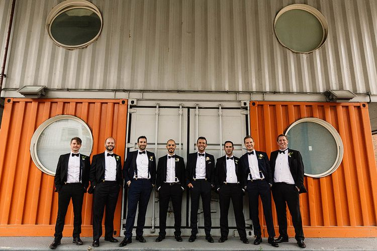 Groom & Groomsmen In Black Tie // London Wedding Venue For 300 People Trinity Buoy Wharf With Bride In Suzanne Neville And Images From Paul Joseph Photography Film This Modern Revelry