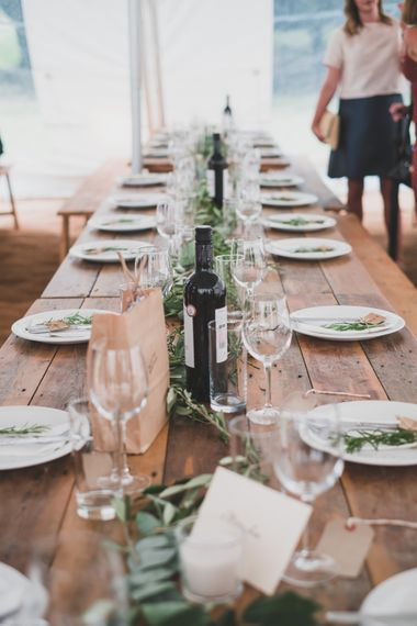 Foliage Runner For Wooden Trestle Table // Rainy Festival Wedding In East Sussex With Bride In Rime Arodaky And Black Biker Boots And Bridesmaids In White Dresses With Silent Disco Party Images By Jesus Caballero