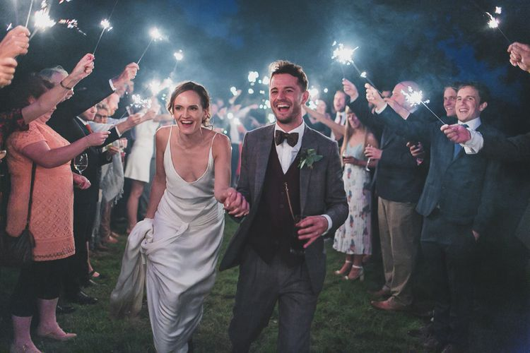 Sparklers At Wedding // Rainy Festival Wedding In East Sussex With Bride In Rime Arodaky And Black Biker Boots And Bridesmaids In White Dresses With Silent Disco Party Images By Jesus Caballero