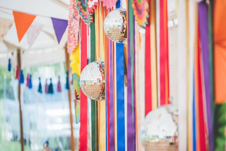 Bright ribbon homemade bunting and glitter ball decoration at marquee celebration