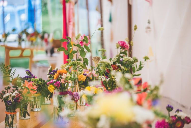Bright ribbon and colourful flower decoration at marquee celebration