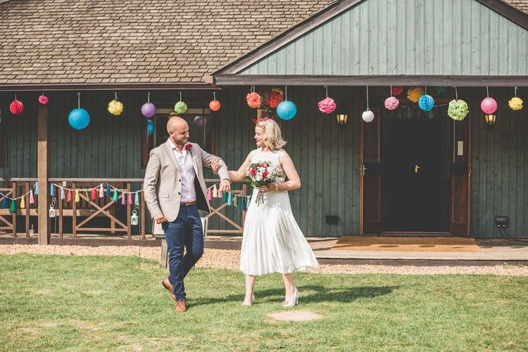 Bright paper lantern decoration and bride wearing midi wedding skirt