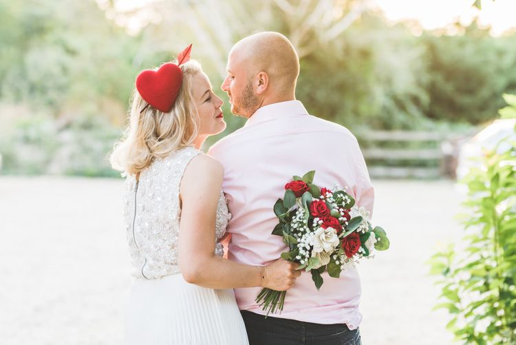Beautiful two piece gown with pleated midi wedding skirt and bright homemade paper wedding bouquet