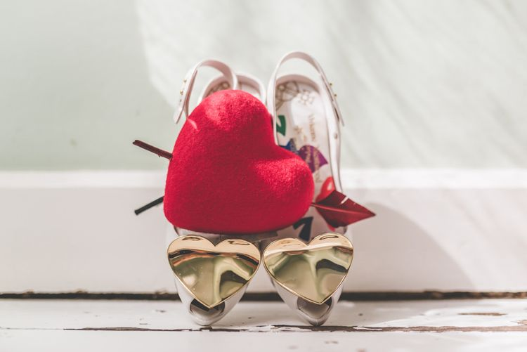 Vivienne Westwood shoes and bright heart hair accessory for fun village fete themed day
