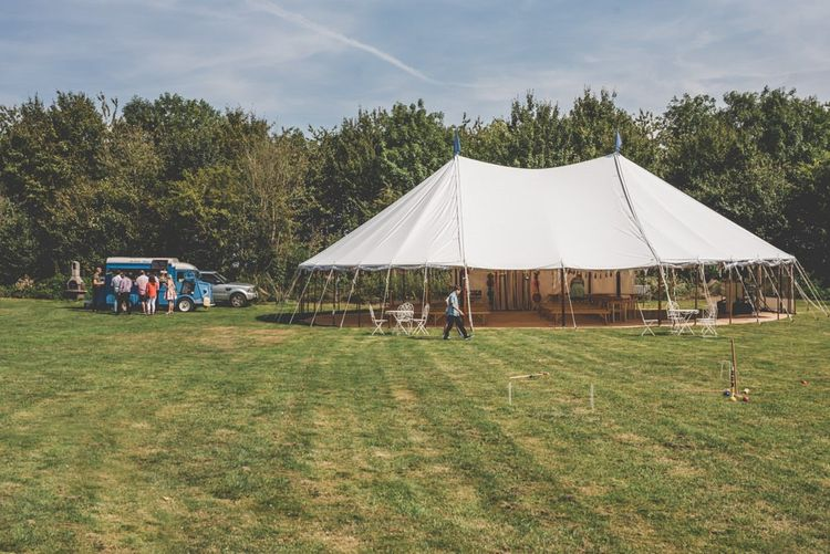 Marquee in the grounds for this fun and bright ceremony