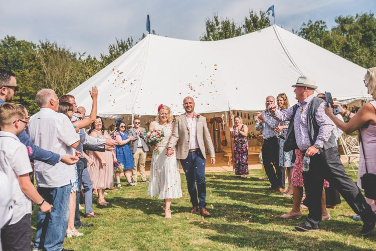 Confetti shot at fun fete themed celebration with midi wedding skirt and bright accessories