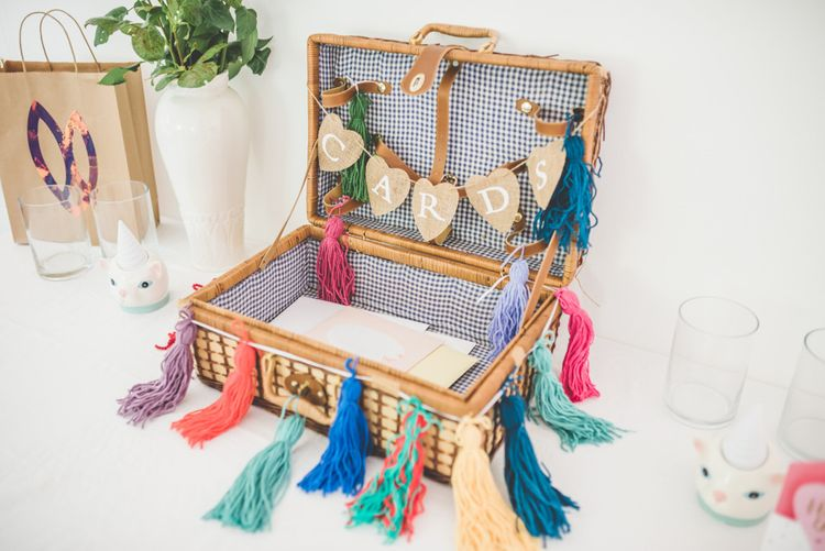 Homemade colourful tassel decoration for personalised card box at fun reception